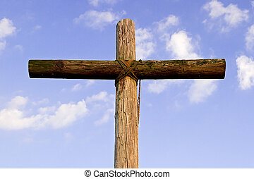 Vieja cruz y cielo azul