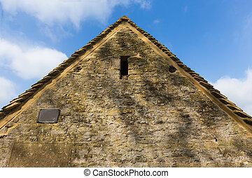 Vista lateral de la casa de piedra en Cotswold, Inglaterra