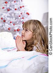 Xmas rezando